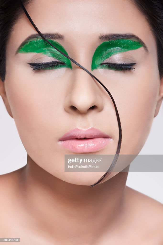 Young woman with make-up on face : Stock Photo
