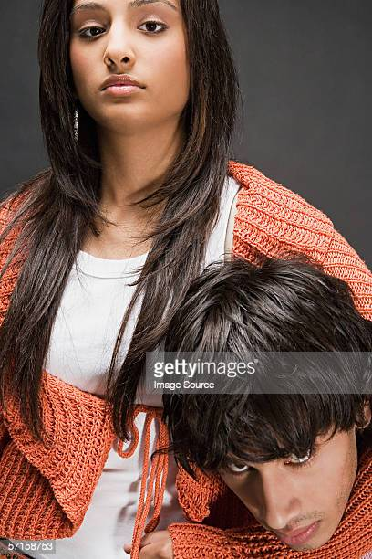 Young woman with man in headlock