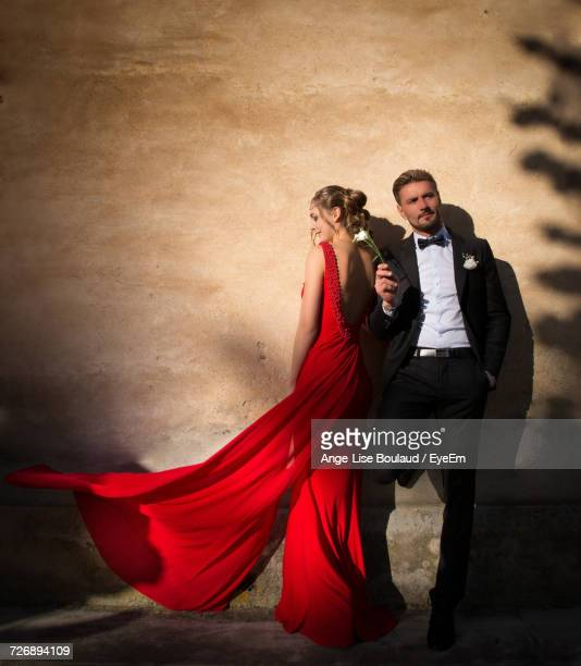 young woman with man - evening gown stock photos and pictures