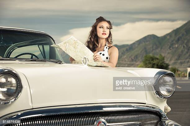 Young Woman with Map on Road Trip
