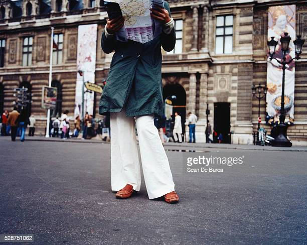 Young woman with map, Paris, France