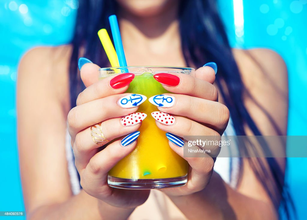 Young woman with marine sailor manicure : Stock Photo
