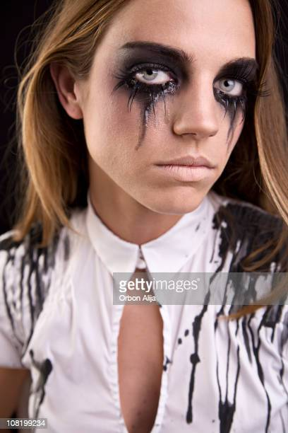 Young Woman with Mascara Running Down Cheeks Crying