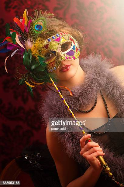 young woman with masquerade mask