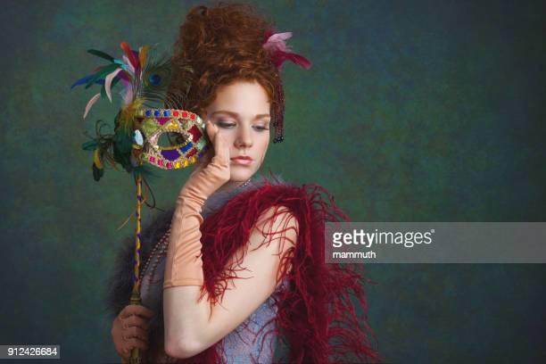 young woman with masquerade mask - maschere veneziane foto e immagini stock