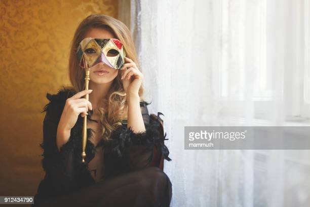 young woman with masquerade mask - fat tuesday stock pictures, royalty-free photos & images