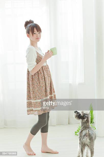 Young Woman with Miniature Schnauzer