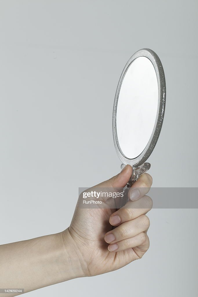 young woman with mirror : Stock Photo