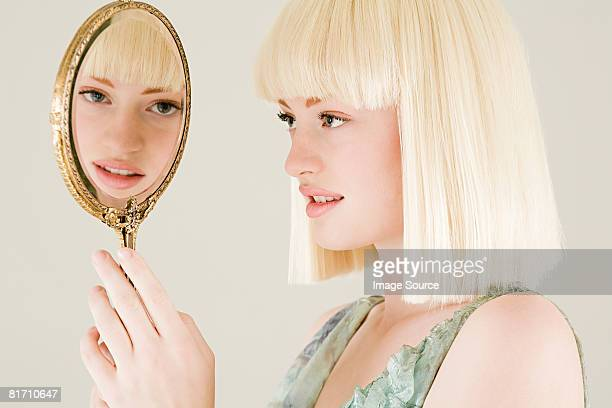 young woman with mirror - hand mirror stock photos and pictures