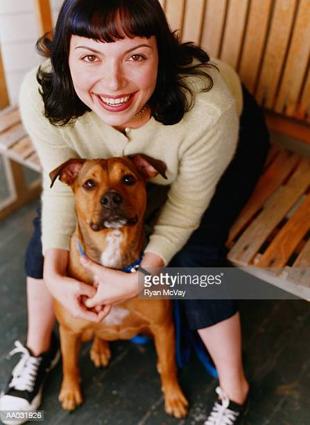 young woman with mixed breed dog - mongrel dog stock pictures, royalty-free photos & images