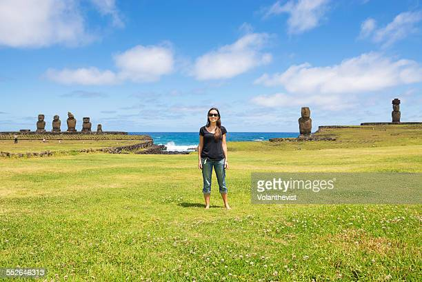 Young woman with moai statues in Easter Island