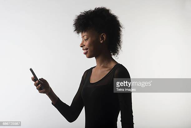 young woman with mobile phone - neckline stock pictures, royalty-free photos & images