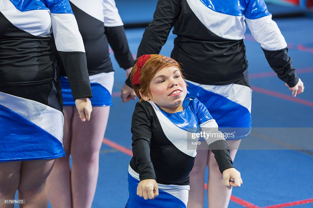 Young woman with Morquio syndrome on cheerleading team : Stock Photo