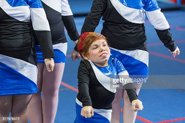 young woman with morquio syndrome on cheerleading team - candid cheerleaders stock photos and pictures