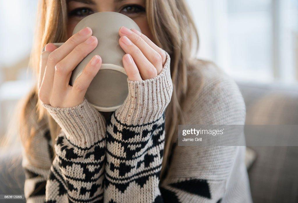 Young woman with mug : Stock Photo