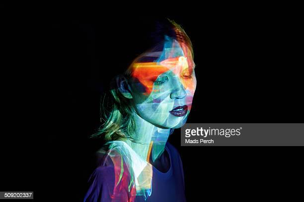 Young Woman with Multicolored Light in her Face