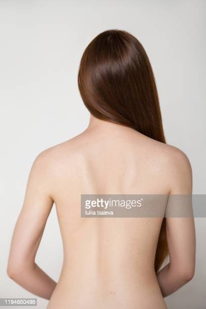 young woman with naked back - 裸 ストックフォトと画像