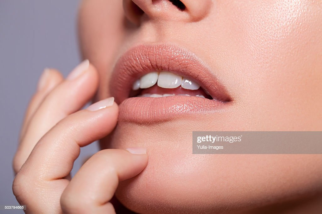 Young Woman with Natural Make Up Touching Face : Stock Photo