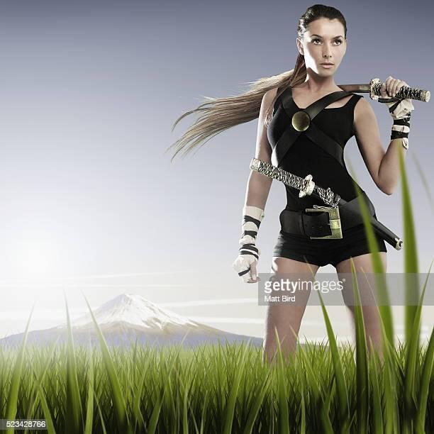 Young woman with ninja swords