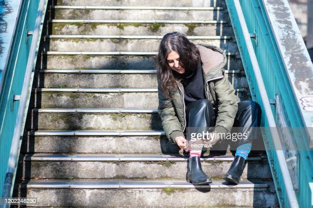 young woman with odd socks on - mismatch stock pictures, royalty-free photos & images