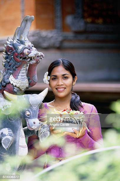 young woman with offerings - balinese culture stock pictures, royalty-free photos & images