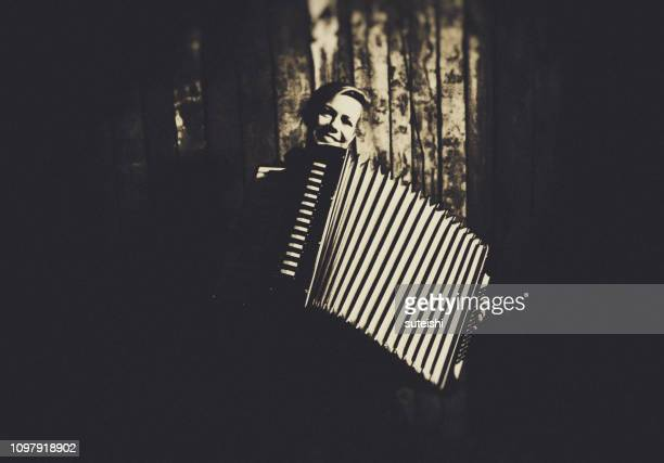 young woman with old accordion - accordionist stock pictures, royalty-free photos & images
