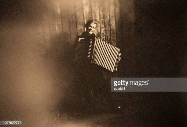 young woman with old accordion - accordion instrument stock pictures, royalty-free photos & images