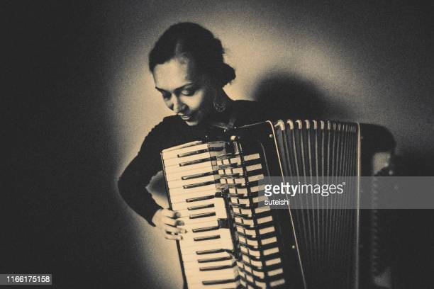 young woman with old accordion - musician stock pictures, royalty-free photos & images