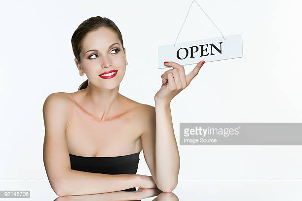 young woman with open sign - open source photos et images de collection