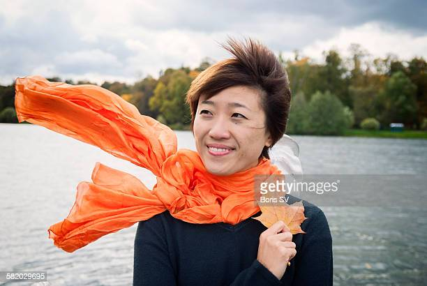 Young woman with orange scarf
