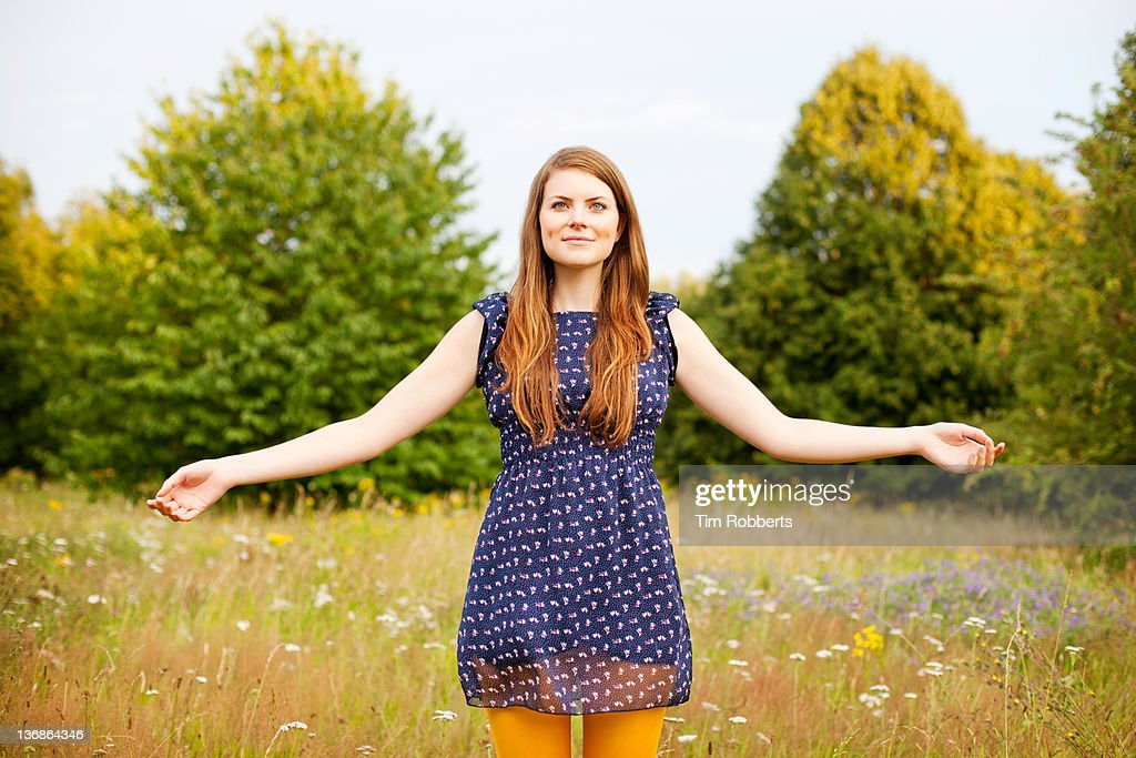 Young woman with outstretched arms. : Bildbanksbilder
