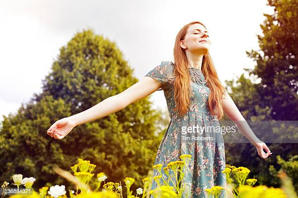 young woman with outstretched arms. - spirituality stock pictures, royalty-free photos & images