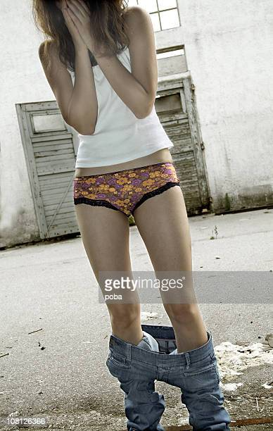 young woman with pants down - pants stock photos and pictures