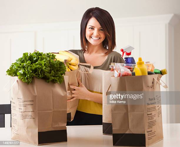 Young woman with paper bags after shopping