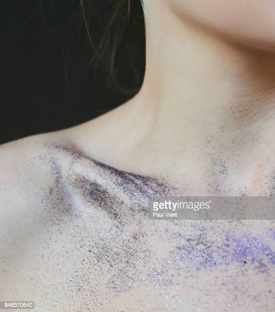 Young woman with party glitter on skin
