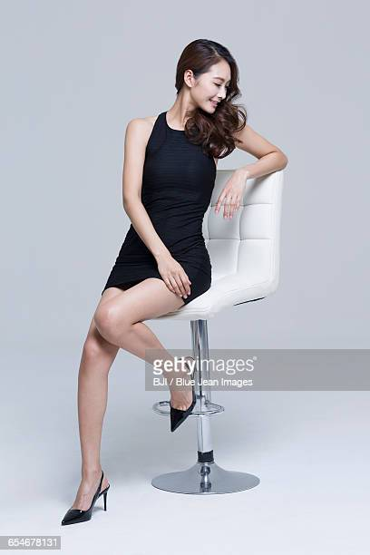 young woman with perfect body - mini dress stock photos and pictures