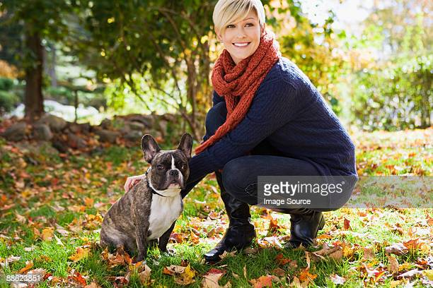 young woman with pet dog - neckwear stock pictures, royalty-free photos & images