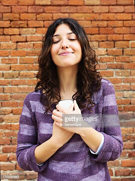 Young woman with phone smiling