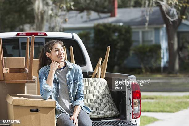 Young woman with pickup truck, moving house