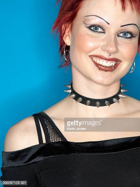 young woman with pierced lip wearing studded collar, smiling, portrait - jordan punk ストックフォトと画像