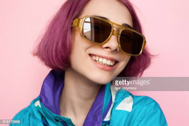 young woman with pink hair laughing - styles stock pictures, royalty-free photos & images