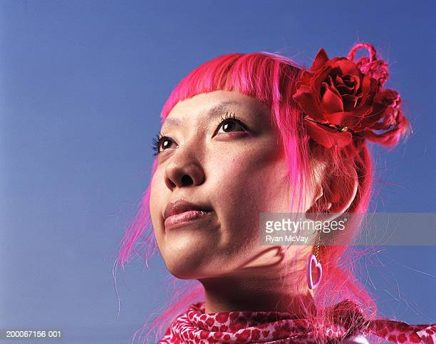 Young woman with pink hair looking away, portrait