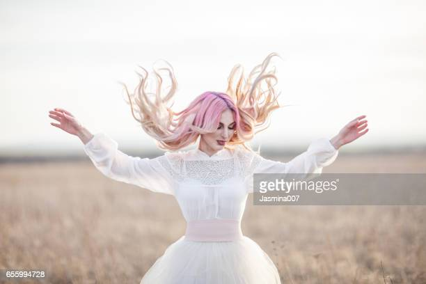 young woman with pink hair outdoors - pink dress stock photos and pictures