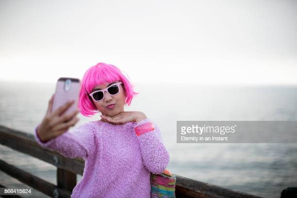 young woman with pink hair taking a selfie - puckering stock pictures, royalty-free photos & images