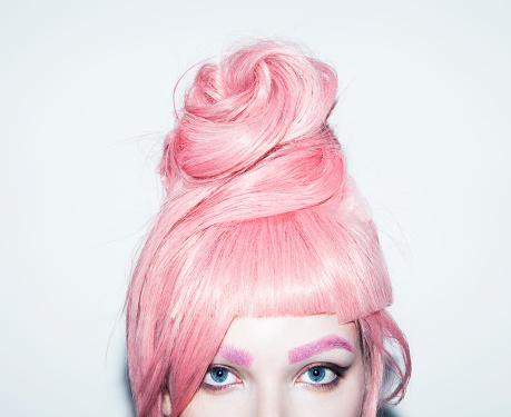 Young woman with pink hair wig in an updo, crop. - gettyimageskorea