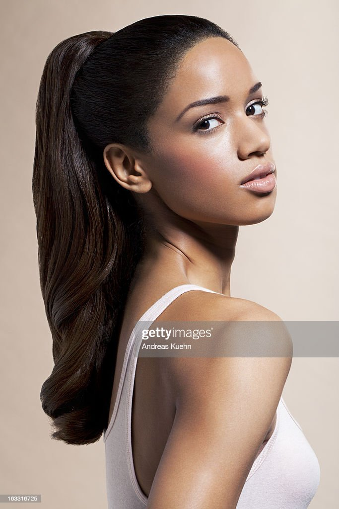 Naked Young Woman With Hair Blowing Portrait High-Res