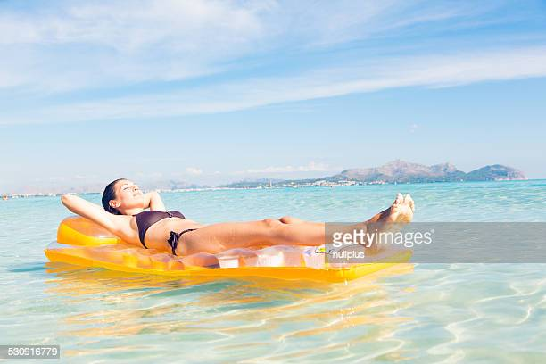 young woman with pool raft