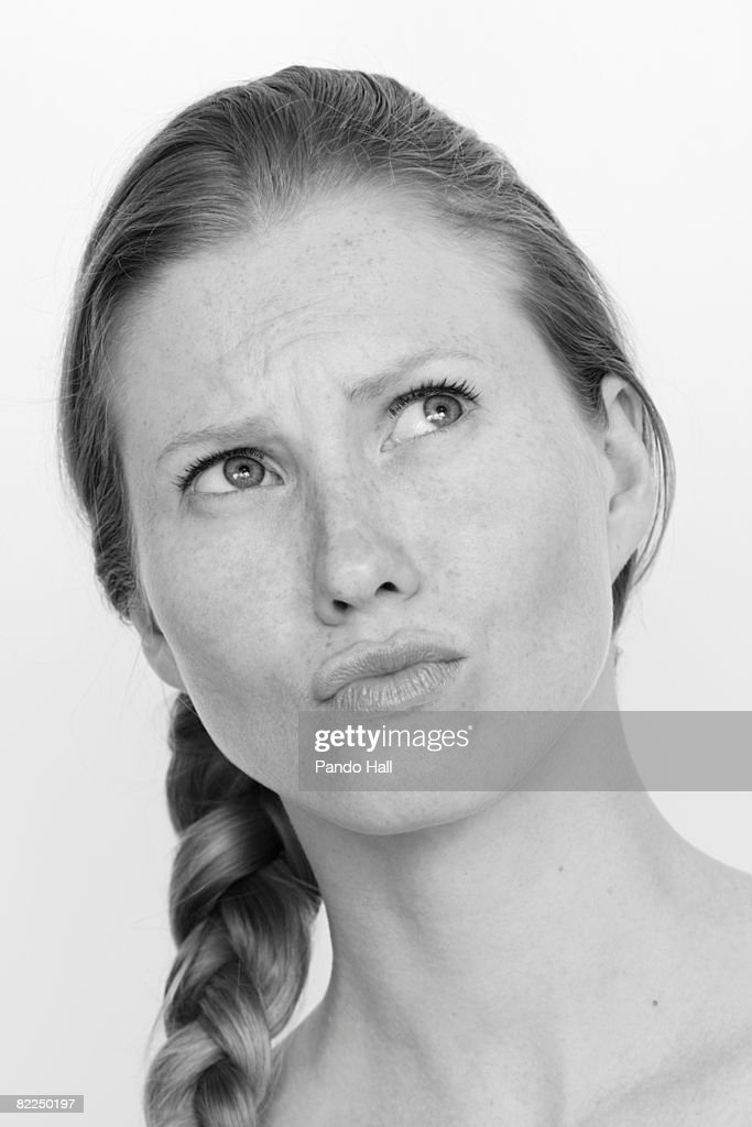 Young woman with puckered lips : Stock Photo