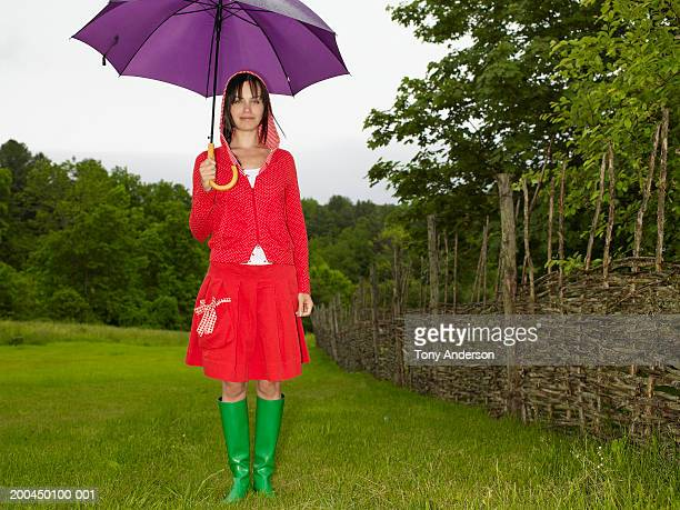 young woman with purple umbrella, portrait - chatham new york state stock pictures, royalty-free photos & images