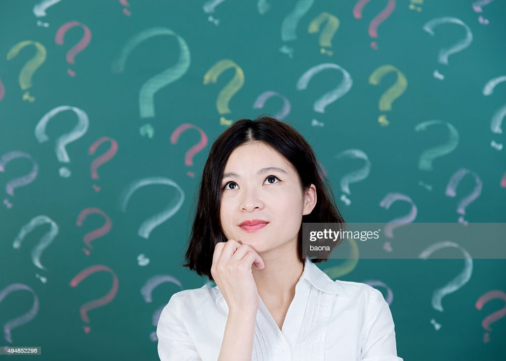 Young woman with question mark : Stock Photo
